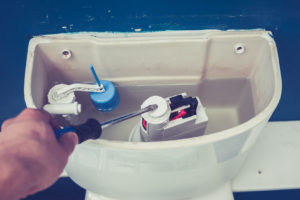25769742 ml 300x200 - 25769742 - hand is fixing a toilet cistern at home